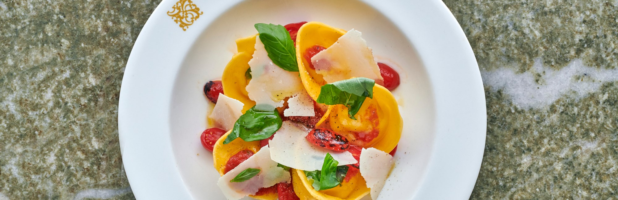daphnes provola tortelloni with datterini basil